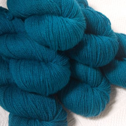 Llŷr - Deep petrol blue Bluefaced Leicester DK (double knit) yarn hand-dyed by Triskelion Yarns