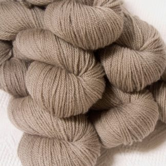 Pebble - Pale greyish brown Bluefaced Leicester DK (double knit) yarn hand-dyed by Triskelion Yarns