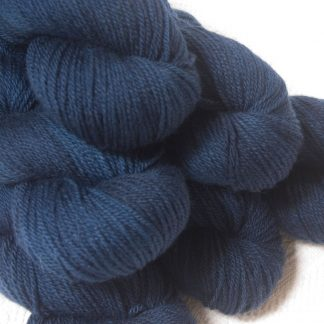 Penumbral - Dark navy Bluefaced Leicester DK (double knit) yarn hand-dyed by Triskelion Yarns