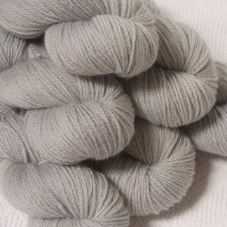Rime - Pale silver grey Bluefaced Leicester DK (double knit) yarn hand-dyed by Triskelion Yarns