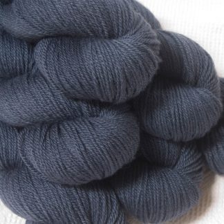 Storm - Mid- to dark bluish grey Bluefaced Leicester DK (double knit) yarn hand-dyed by Triskelion Yarns