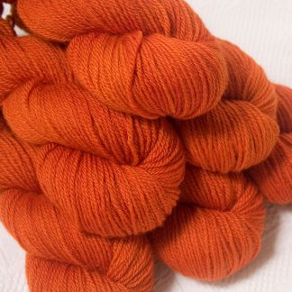 Sunburst - Bright mid- to dark orange Bluefaced Leicester DK (double knit) yarn hand-dyed by Triskelion Yarns