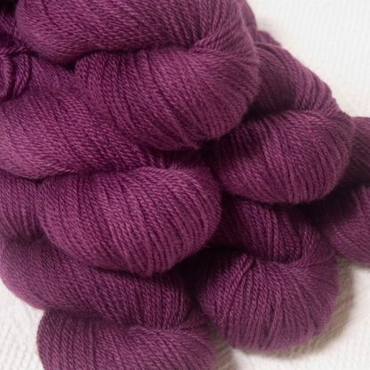 Tyrian Purple - Dark reddish purple Bluefaced Leicester DK (double knit) yarn hand-dyed by Triskelion Yarns
