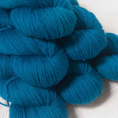 Wade - Mid-toned cerulean blue Bluefaced Leicester DK (double knit) yarn hand-dyed by Triskelion Yarns