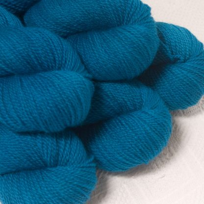 Ælfred - Mid-toned royal blueBluefaced Leicester sport weight yarn hand-dyed by Triskelion Yarns