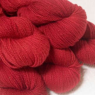 Boötes - Mid- to dark red Bluefaced Leicester sport weight yarn hand-dyed by Triskelion Yarns