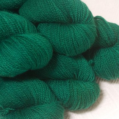 Dinas Emrys - Mid- to dark emerald green Bluefaced Leicester sport weight yarn hand-dyed by Triskelion Yarns