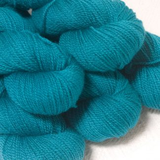 Fiachra - Mid-tone turquoise Bluefaced Leicester sport weight yarn hand-dyed by Triskelion Yarns