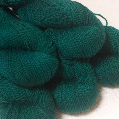 Grendel - Dark bluish-green Bluefaced Leicester sport weight yarn hand-dyed by Triskelion Yarns