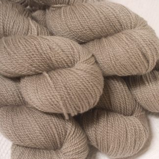 Pebble - Pale greyish brown Bluefaced Leicester sport weight yarn hand-dyed by Triskelion Yarns