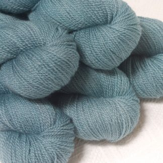 Spring Rain - Light grey-blue Bluefaced Leicester sport weight yarn hand-dyed by Triskelion Yarns