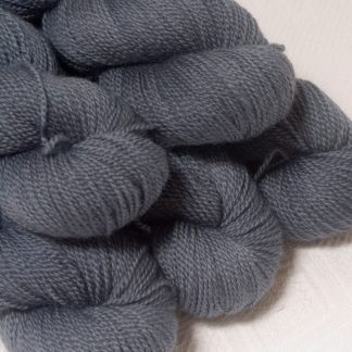 Storm - Mid- to dark bluish grey Bluefaced Leicester sport weight yarn hand-dyed by Triskelion Yarns