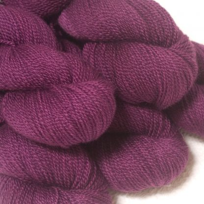 Tyrian Purple - Dark reddish purple Bluefaced Leicester sport weight yarn hand-dyed by Triskelion Yarns