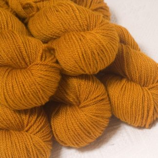 Amber - Dark ochre yellow Bluefaced Leicester worsted weight yarn hand-dyed by Triskelion Yarns