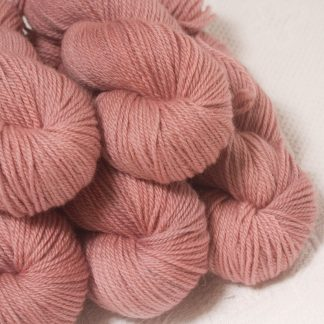 Ash Rose - Light greyish pink Bluefaced Leicester worsted weight yarn hand-dyed by Triskelion Yarns