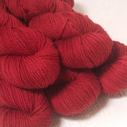 Boötes - Mid- to dark red Bluefaced Leicester worsted weight yarn hand-dyed by Triskelion Yarns