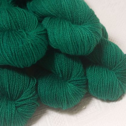 Dinas Emrys - Mid- to dark emerald green Bluefaced Leicester worsted weight yarn hand-dyed by Triskelion Yarns