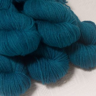 Llŷr - Deep petrol blue Bluefaced Leicester worsted weight yarn hand-dyed by Triskelion Yarns