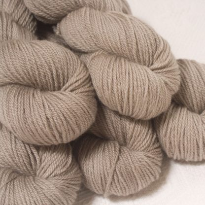 Pebble - Pale greyish brown Bluefaced Leicester worsted weight yarn hand-dyed by Triskelion Yarns