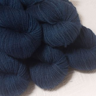 Penumbral - Dark navy blue Bluefaced Leicester worsted weight yarn hand-dyed by Triskelion Yarns
