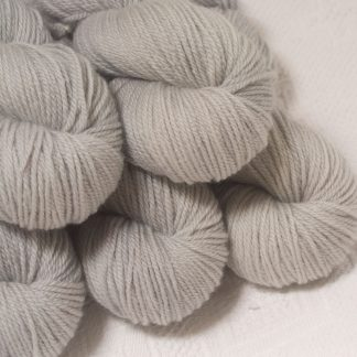 Rime - Pale silver grey Bluefaced Leicester worsted weight yarn hand-dyed by Triskelion Yarns
