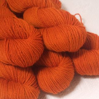Sunburst - Bright mid- to dark orange Bluefaced Leicester worsted weight yarn hand-dyed by Triskelion Yarns