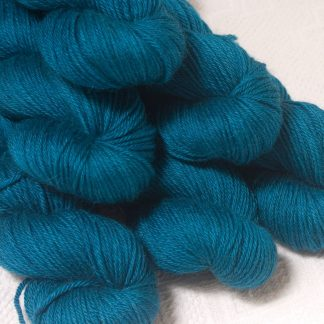 Llŷr - Deep petrol blue Baby Alpaca Silk & Cashmere double-knit yarn. Hand-dyed by Triskelion Yarn.