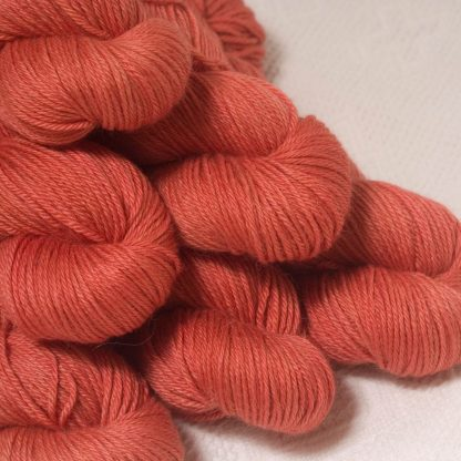 Reef - Mid-tone coral Baby Alpaca Silk & Cashmere double-knit yarn. Hand-dyed by Triskelion Yarn.