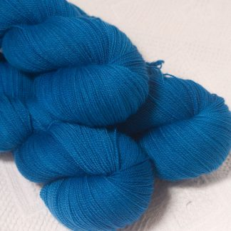 Ælfred - Mid-toned royal blue extra fine Falklands Merino 2-ply laceweight yarn hand-dyed by Triskelion Yarn