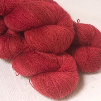 Boötes - Mid- to dark red extra fine Falklands Merino 2-ply laceweight yarn hand-dyed by Triskelion Yarn