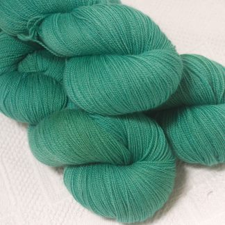 Fionnuala - Light to mid-tone teal green extra fine Falklands Merino 2-ply laceweight yarn hand-dyed by Triskelion Yarn