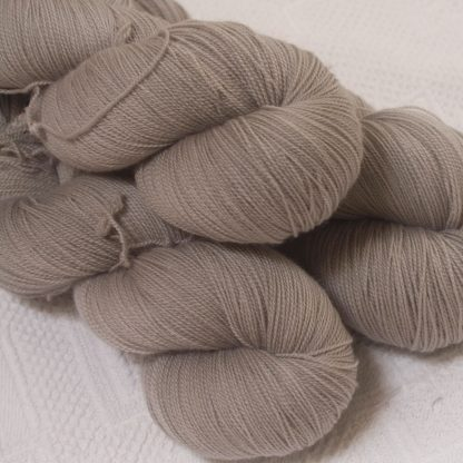 Pebble - Pale greyish brown extra fine Falklands Merino 2-ply laceweight yarn hand-dyed by Triskelion Yarn