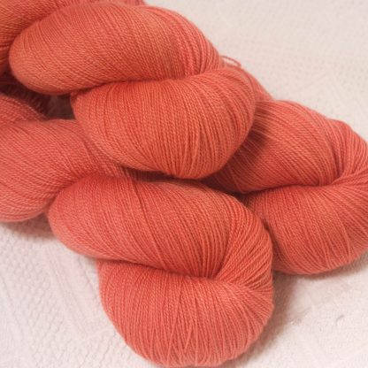 Reef - Mid-tone coral extra fine Falklands Merino 2-ply laceweight yarn hand-dyed by Triskelion Yarn