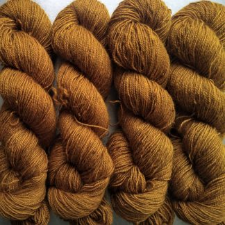 Amber - Dark ochre yellow Bluefaced Leicester (BFL) / Gotland / Wensleydale 4-ply (fingering) weight high-twist sock yarn. Hand-dyed by Triskelion Yarn