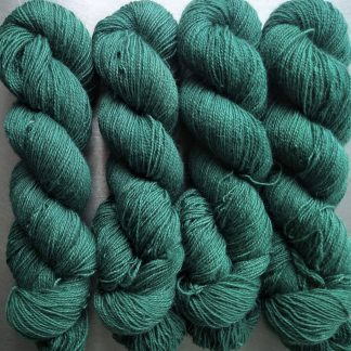 Fionnuala - Light to mid-tone teal green Bluefaced Leicester (BFL) / Gotland / Wensleydale 4-ply (fingering) weight high-twist sock yarn. Hand-dyed by Triskelion Yarn