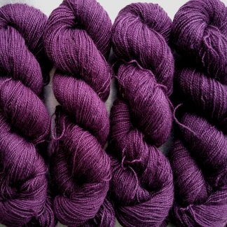 Tyrian Purple - Dark reddish purple Bluefaced Leicester (BFL) / Gotland / Wensleydale 4-ply (fingering) weight high-twist sock yarn. Hand-dyed by Triskelion Yarn