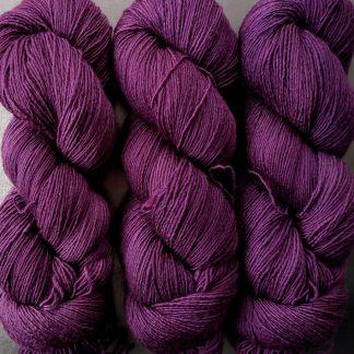 Helleborine - Dark Tyrian red-purple Falklands Merino and silk blend yarn. Hand-dyed by Triskelion Yarn.