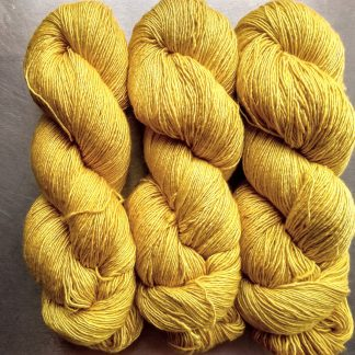 Indian Summer - Light sunny yellow Falklands Merino and silk blend yarn. Hand-dyed by Triskelion Yarn.