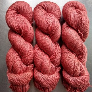 Reef - Light coral pinkish orange Falklands Merino and silk blend yarn. Hand-dyed by Triskelion Yarn.