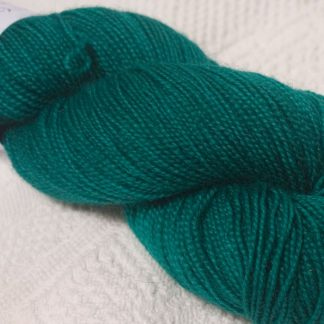 Mid tone turquoise green superwash Bluefaced Leicester (BFL) 4-ply/fingering/sock yarn. Hand-dyed by Triskelion Yarn
