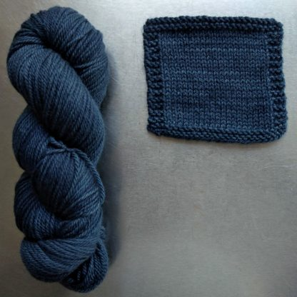 A Giant Turtle's Eyes - A mid to dark grey with a strong aqua undertone Bluefaced Leicester worsted weight yarn hand-dyed by Triskelion Yarn