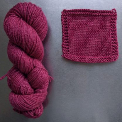 Bloom - Mid tone raspberry rose Bluefaced Leicester worsted weight yarn hand-dyed by Triskelion Yarn