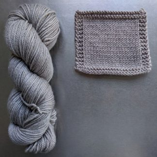 Chesil - Pale warm grey Bluefaced Leicester worsted weight yarn hand-dyed by Triskelion Yarn