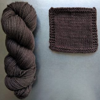 Cwrwgl - Dark cool brown Bluefaced Leicester worsted weight yarn hand-dyed by Triskelion Yarn