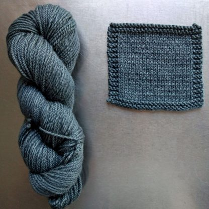 Endless Forms - Mid grey with a sea green-blue undertone Bluefaced Leicester worsted weight yarn hand-dyed by Triskelion Yarn