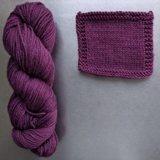 Helleborine - Dark Tyrian red-purple Bluefaced Leicester worsted weight yarn hand-dyed by Triskelion Yarn