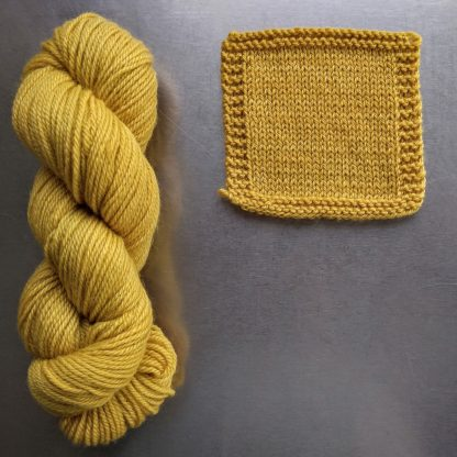Indian Summer - Light sunny yellow Bluefaced Leicester worsted weight yarn hand-dyed by Triskelion Yarn