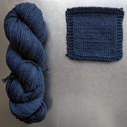 Penumbral - Dark cool navy Bluefaced Leicester worsted weight yarn hand-dyed by Triskelion Yarn