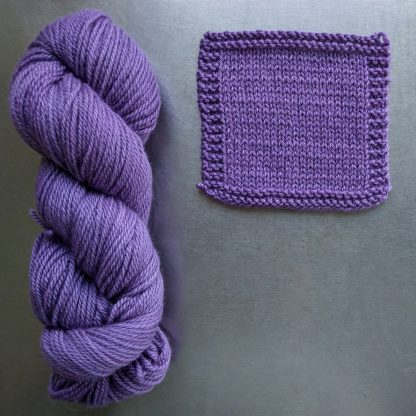 Statice - Light to mid tone violet Bluefaced Leicester worsted weight yarn hand-dyed by Triskelion Yarn