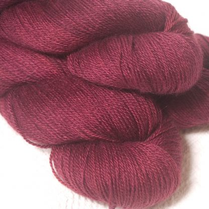 Dark red violet Bluefaced Leicester, silk & cashmere 4-ply yarn. Hand-dyed by Triskelion Yarn.